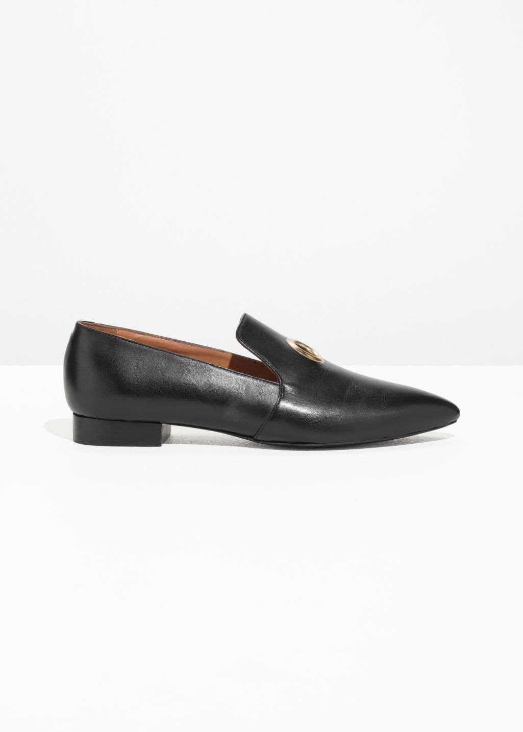 Front image of Stories grommet loafers in black