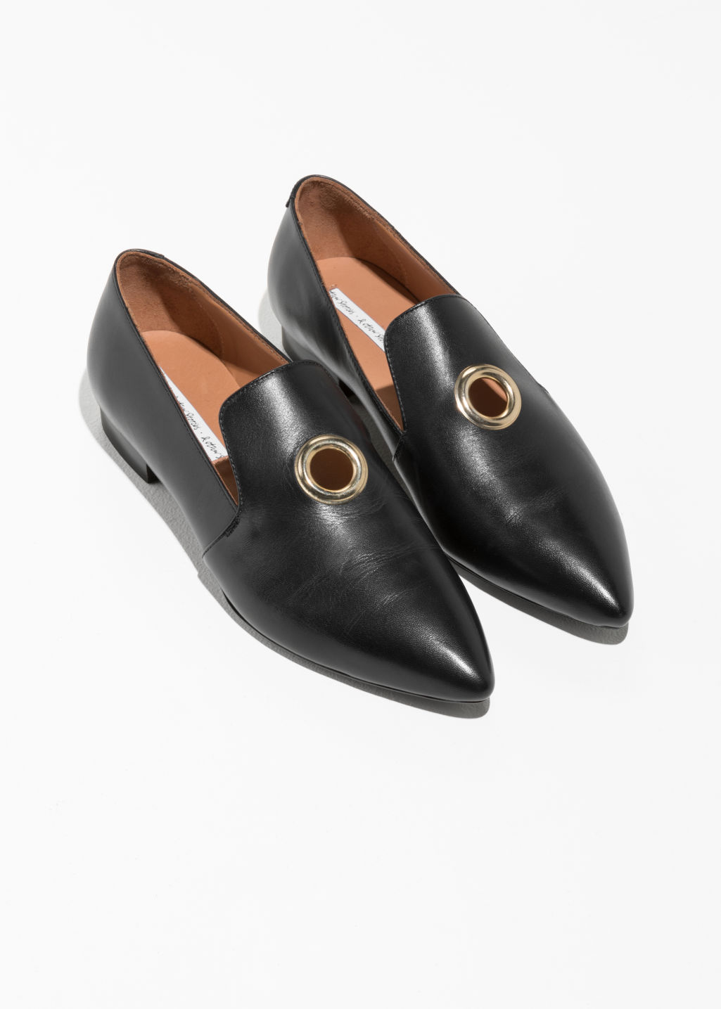Back image of Stories grommet loafers in black