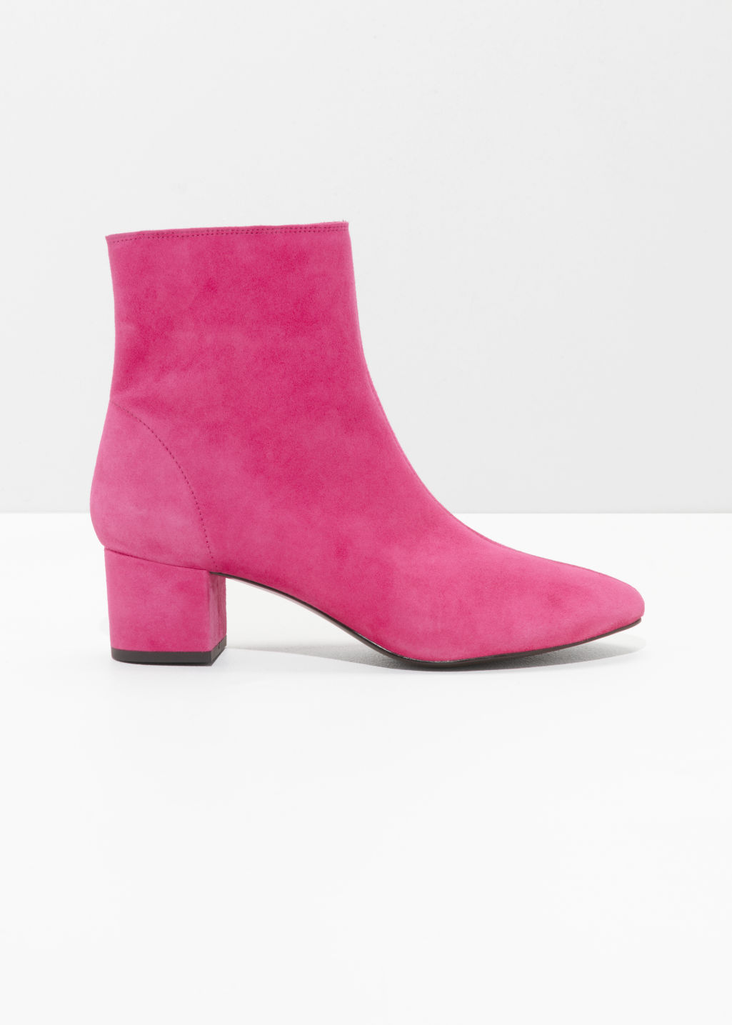 Front image of Stories ankle boots in pink