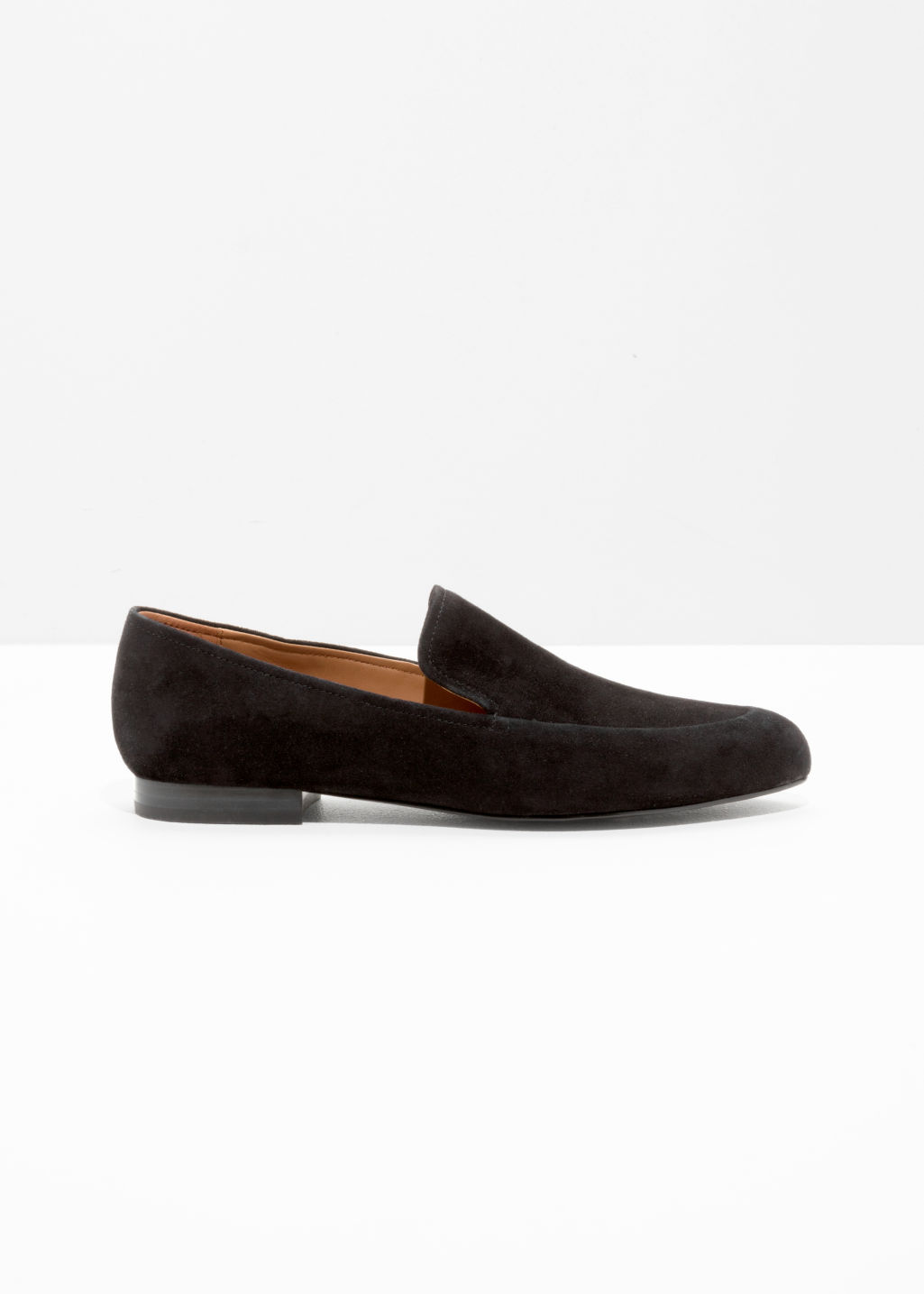 Front image of Stories suede almond toe loafers in black