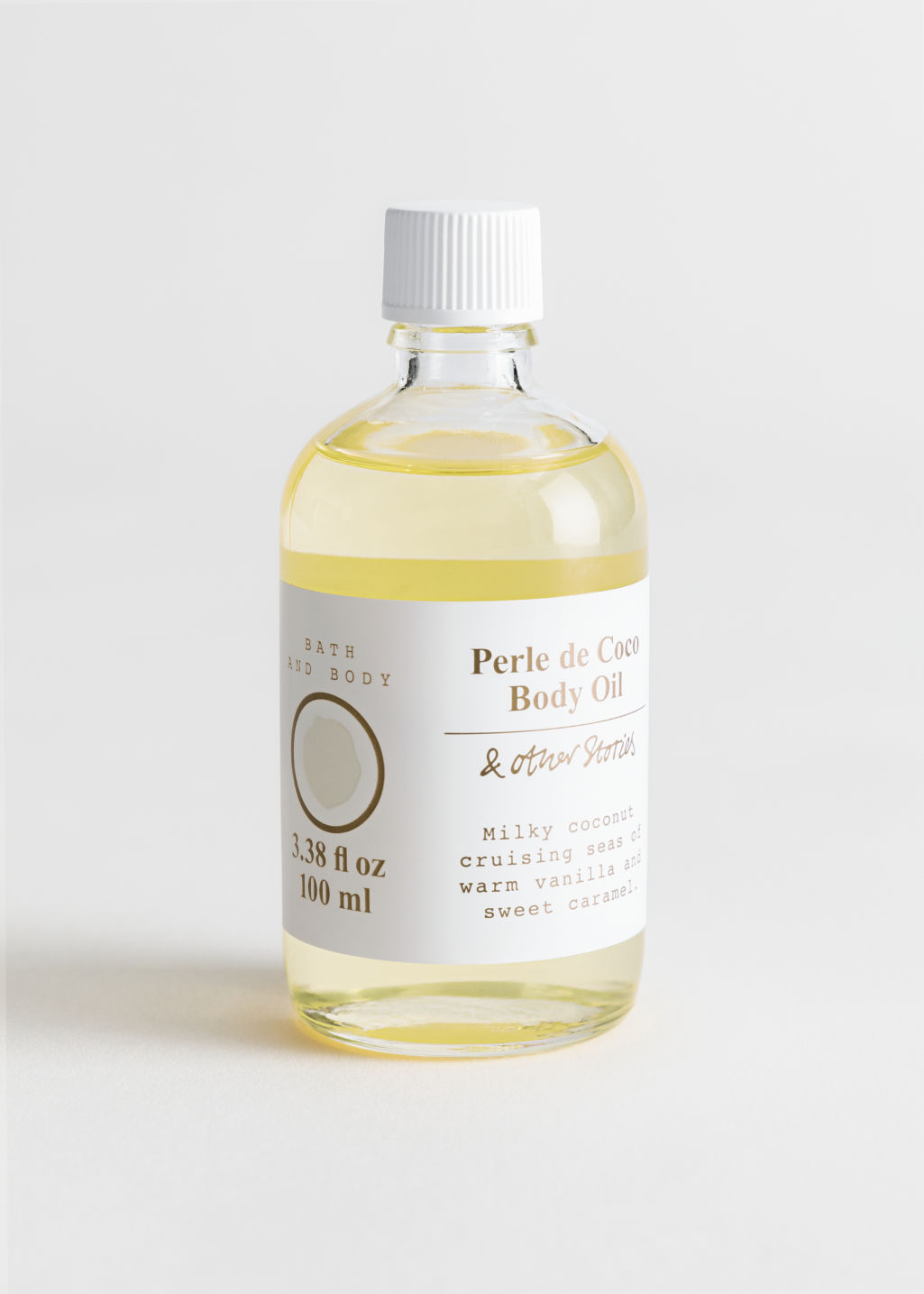 Front image of Stories body oil in white