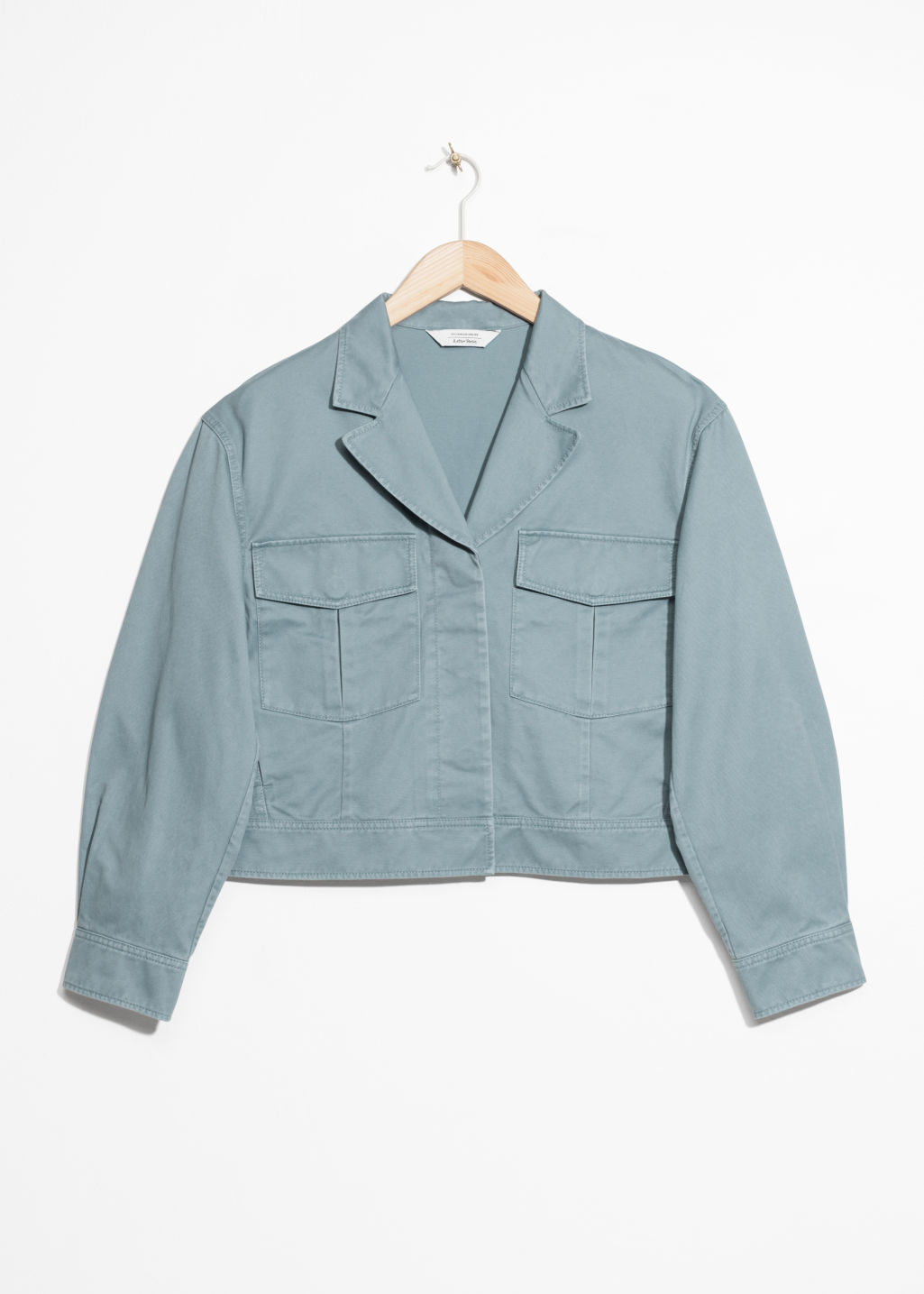 Front image of Stories cropped utilitarian jacket in turquoise