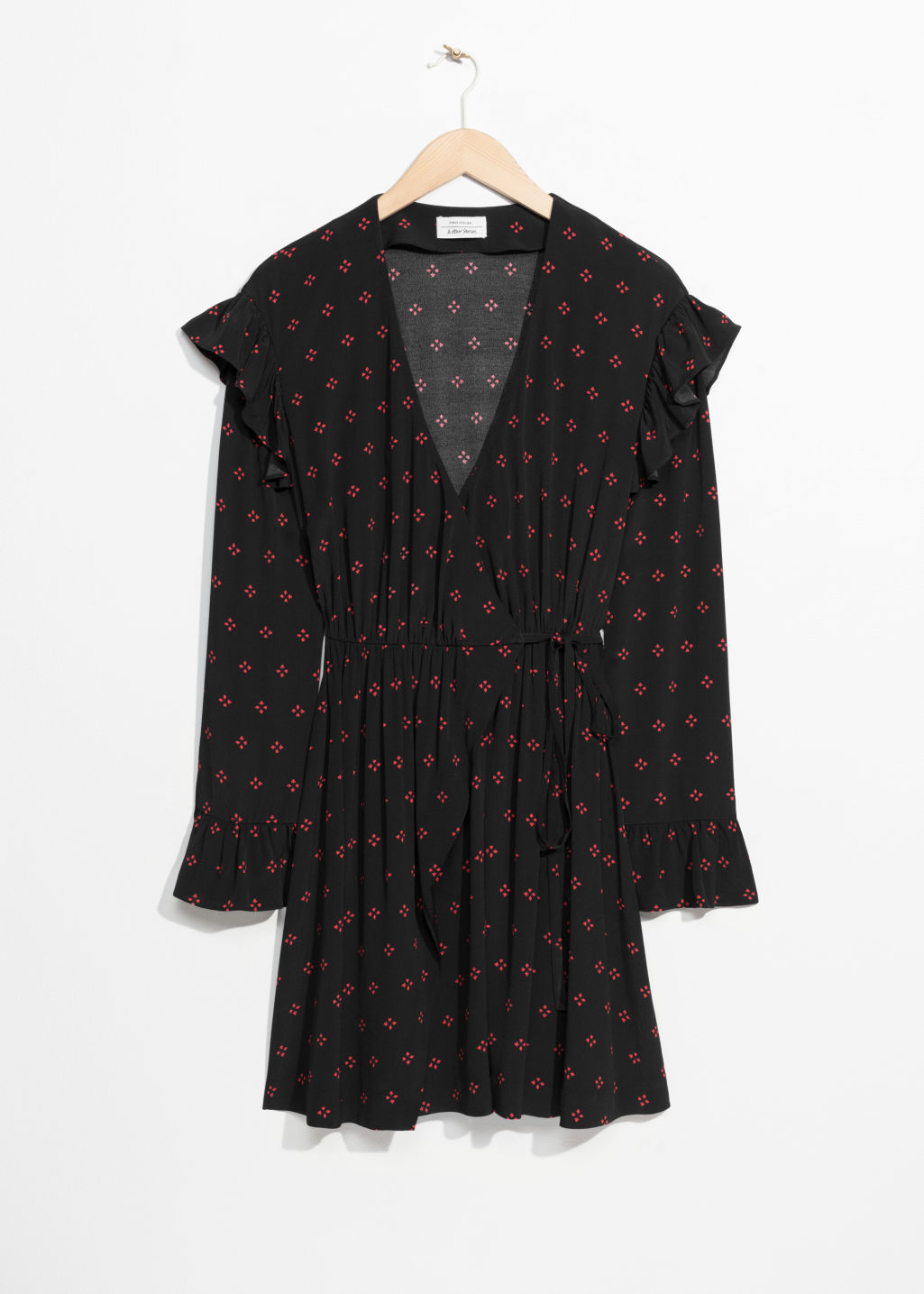 Front image of Stories frill wrap dress in black