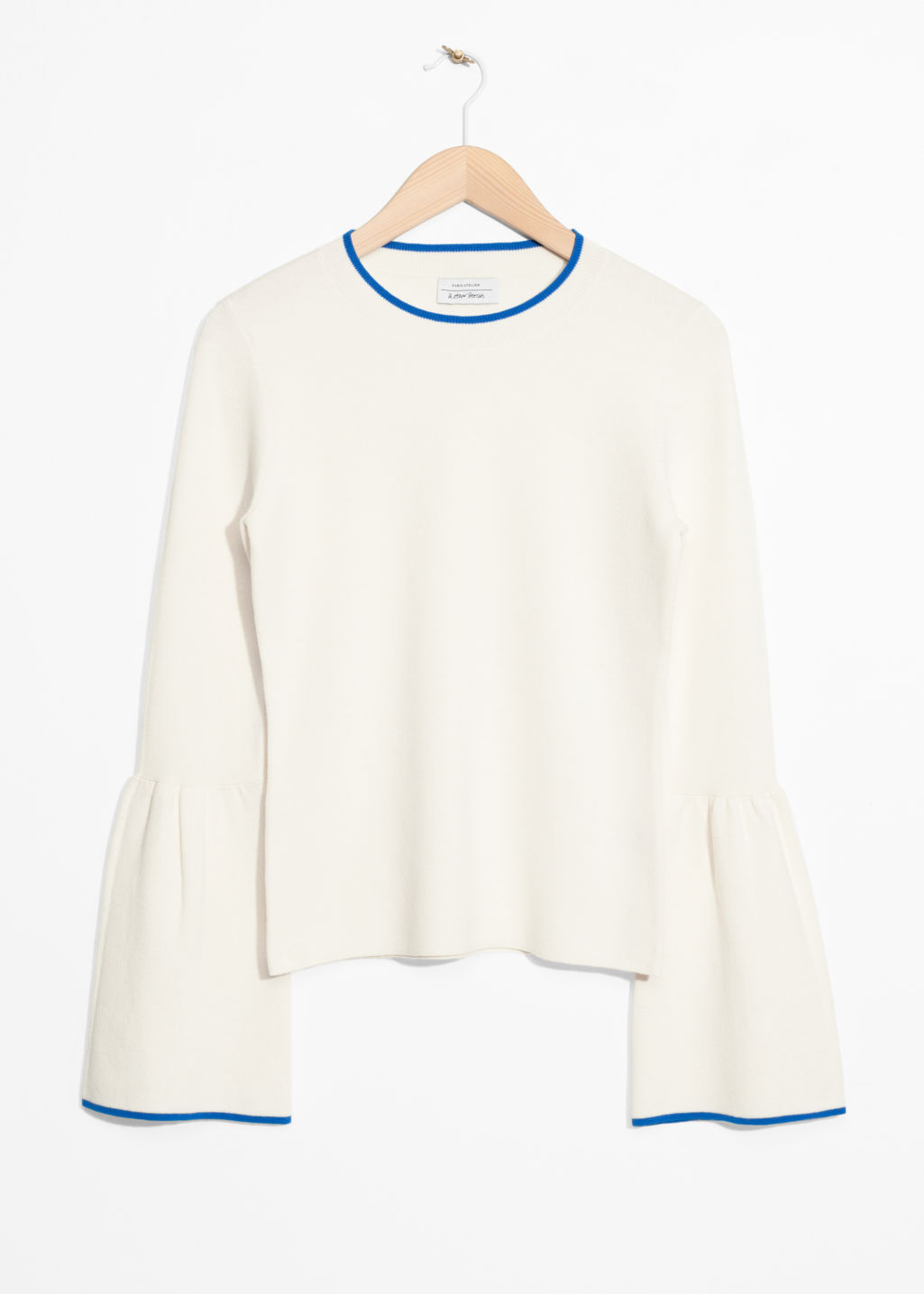 Front image of Stories bell sleeve sweater in white