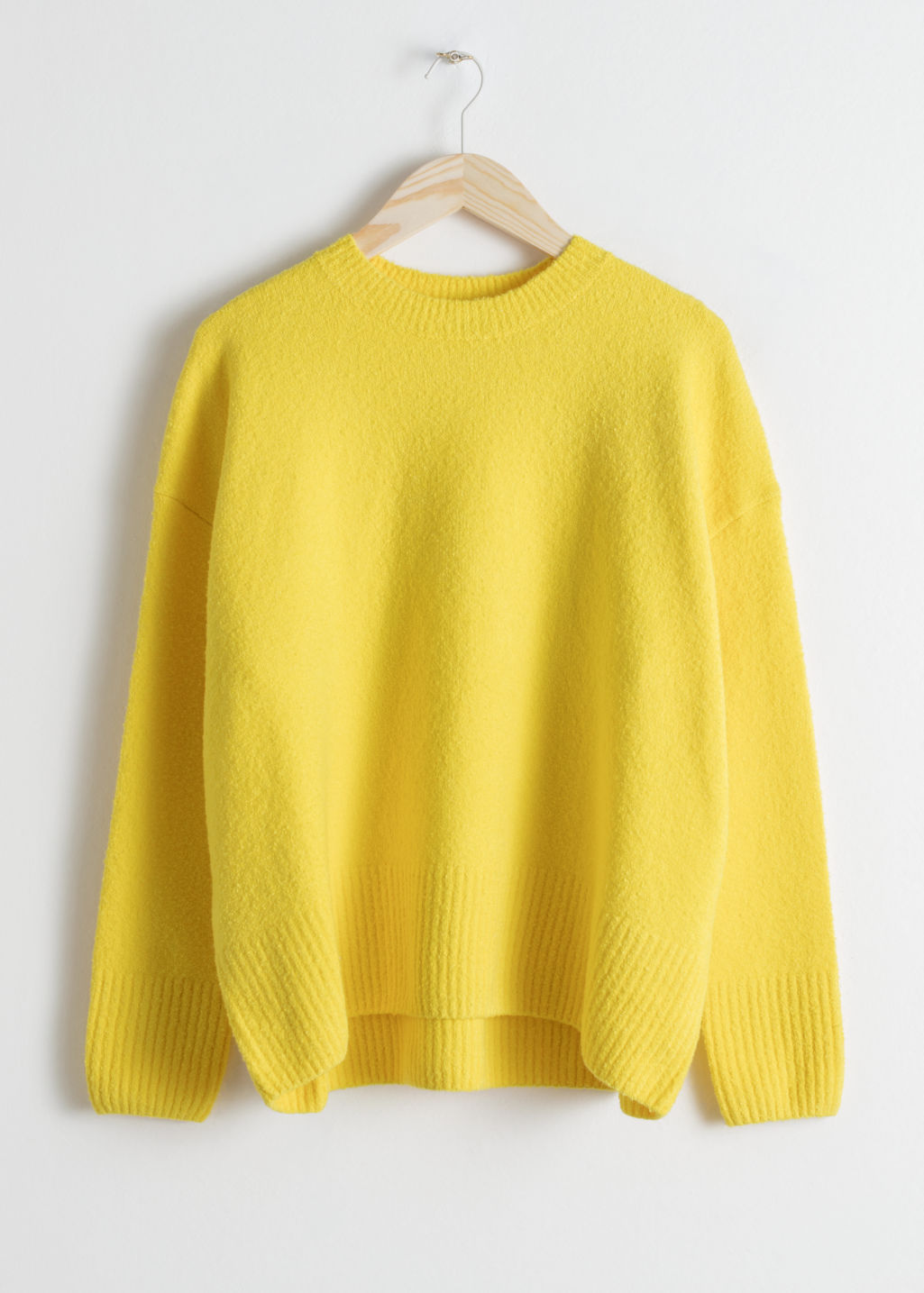 Front image of Stories boxy knit sweater in yellow