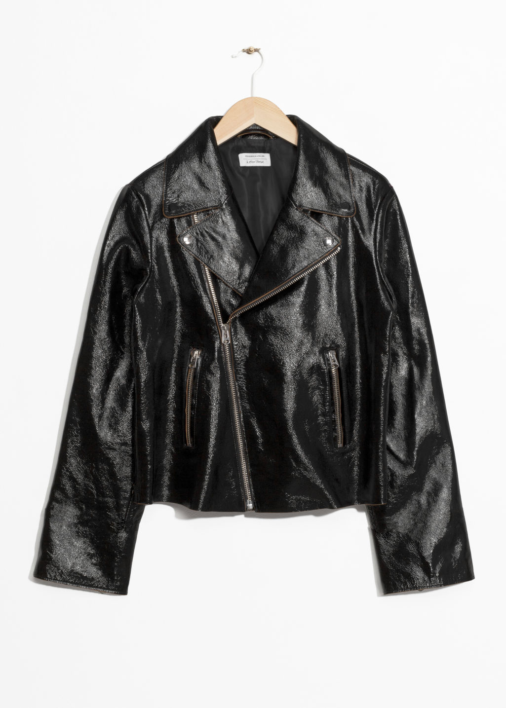 Front image of Stories patent leather biker jacket in black