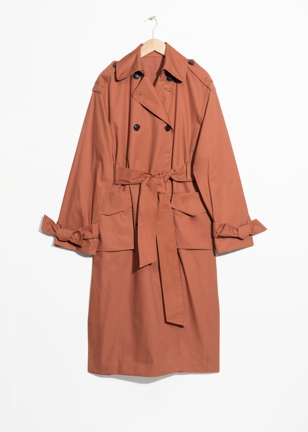 Front image of Stories belted oversized trenchcoat in orange