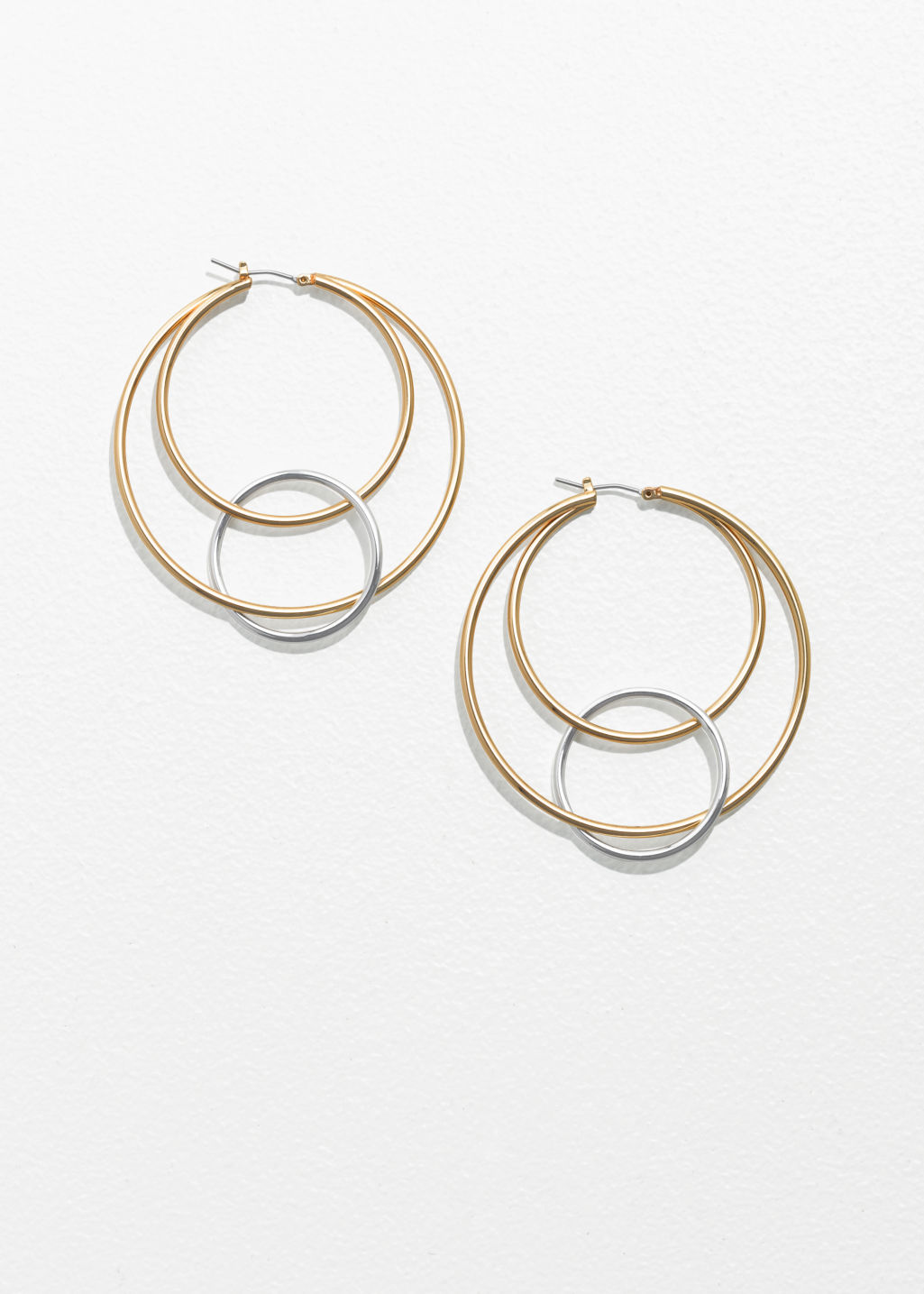 Front image of Stories trio circle hoops in gold
