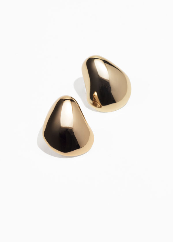 Front image of Stories abstract drop earrings in gold