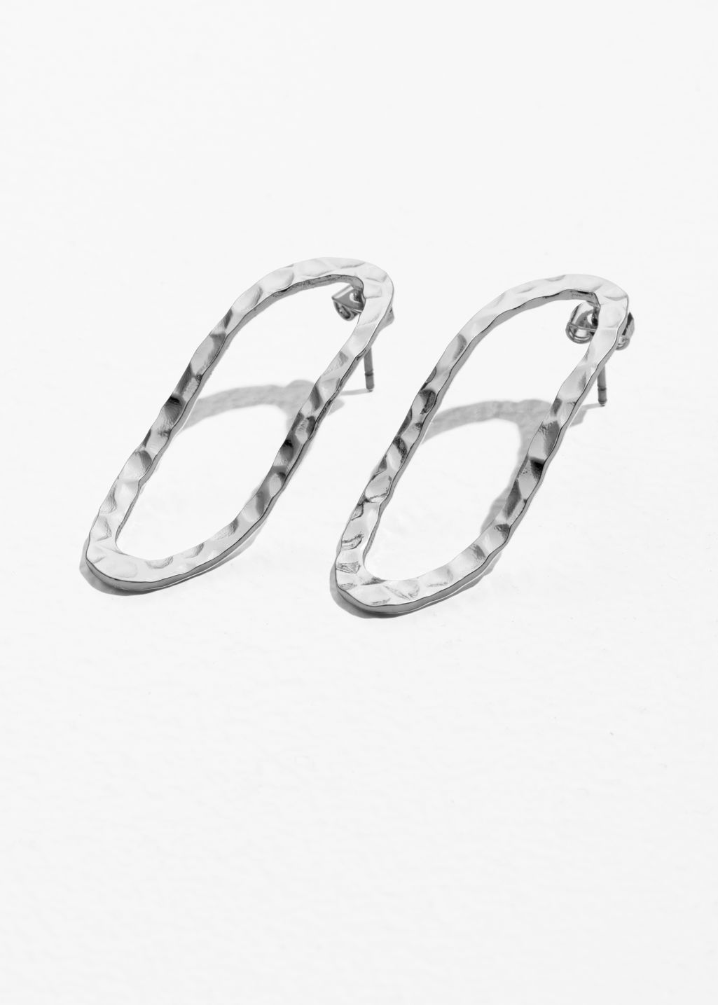 Front image of Stories hammered oval earrings in silver