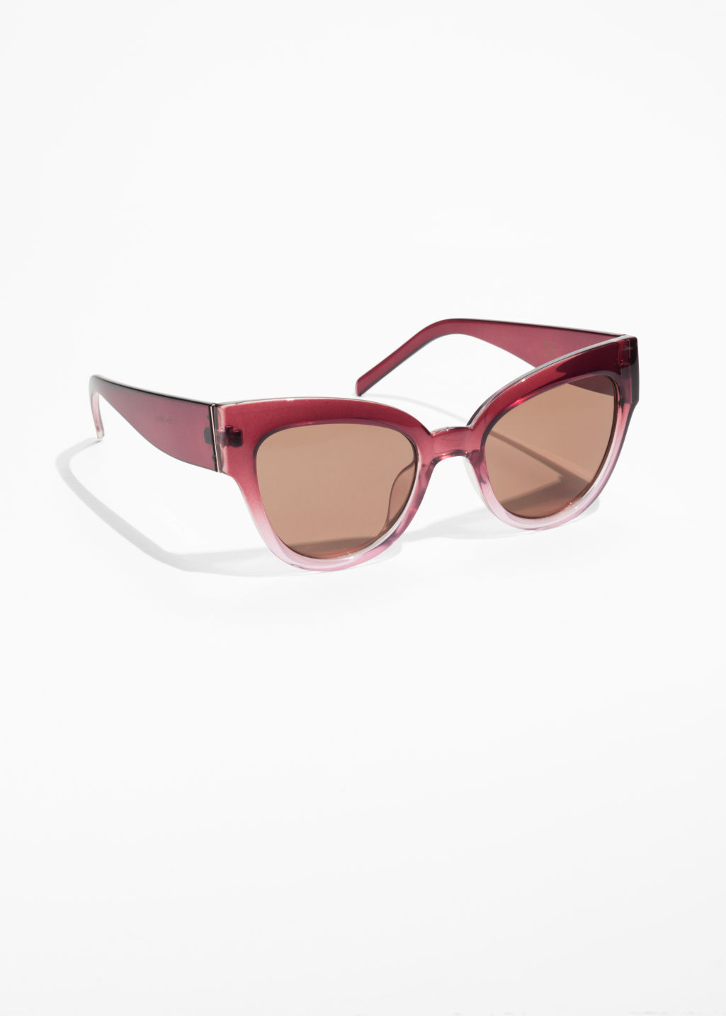 Front image of Stories cat eye sunglasses in pink
