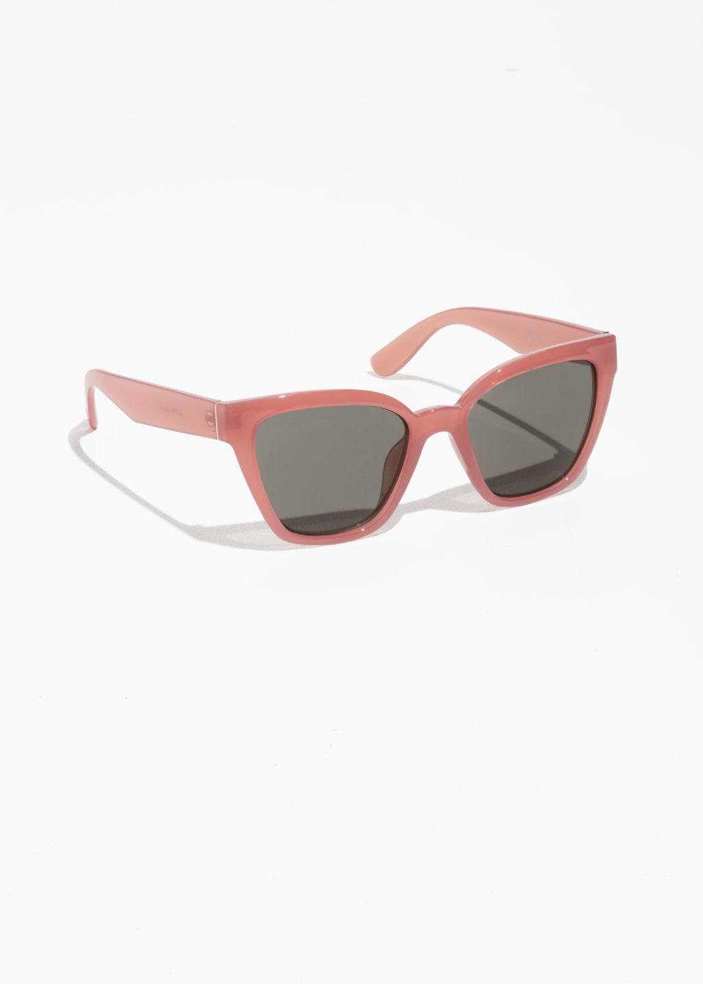 Front image of Stories cat eye sunglasses in red
