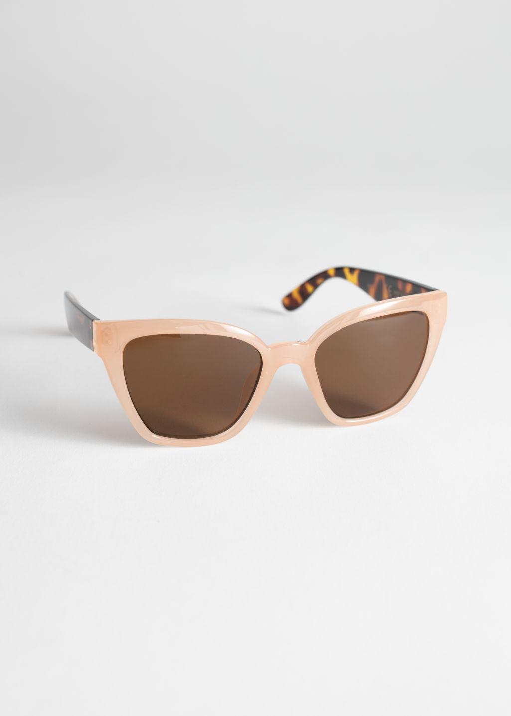 Front image of Stories cat eye sunglasses in orange
