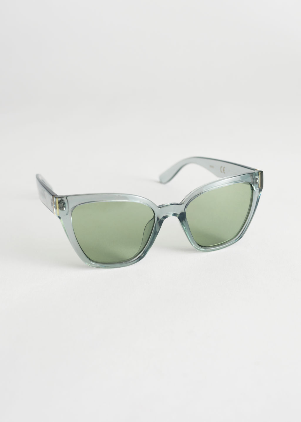 Front image of Stories cat eye sunglasses in green