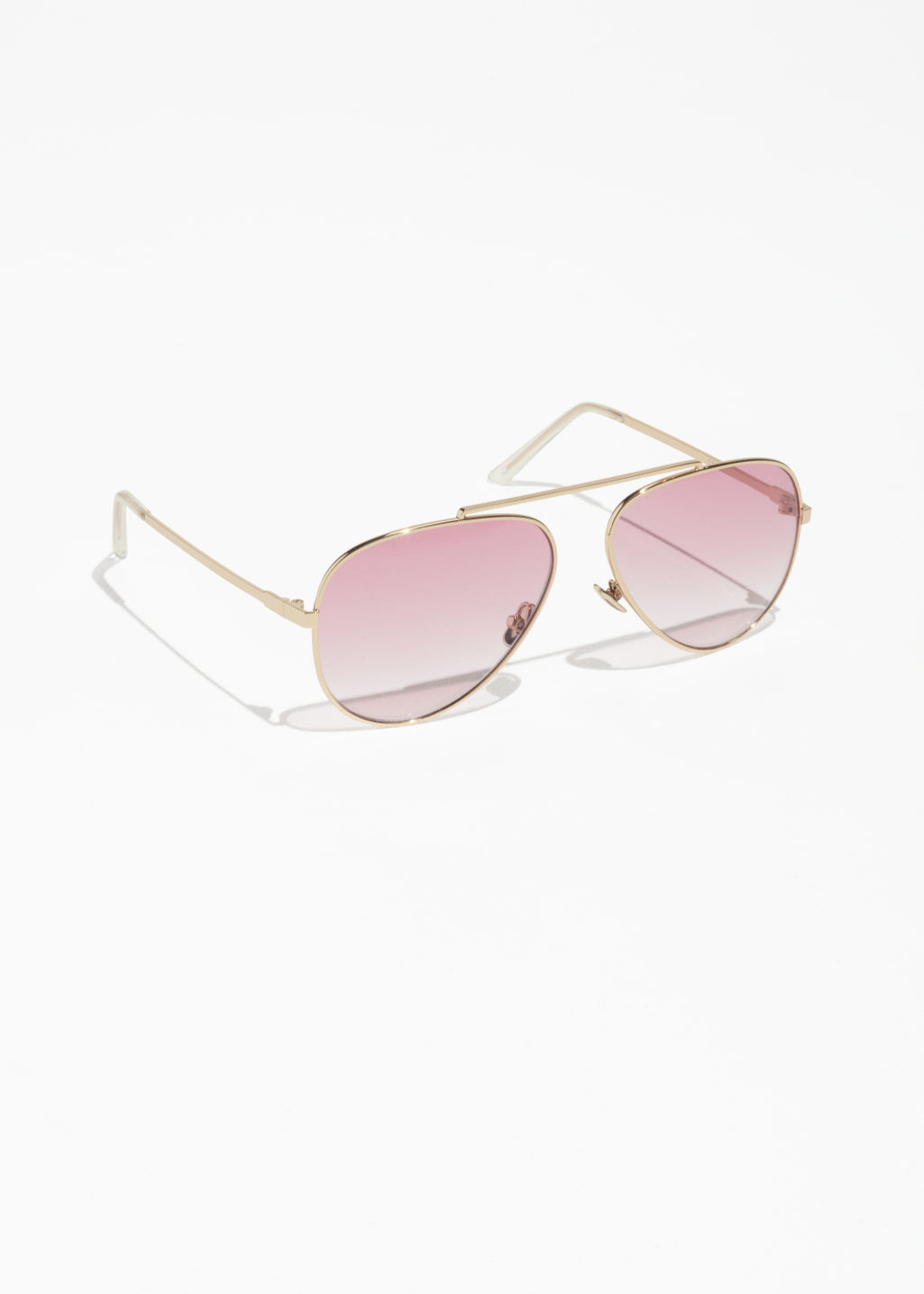 Front image of Stories tinted aviator sunglasses in pink