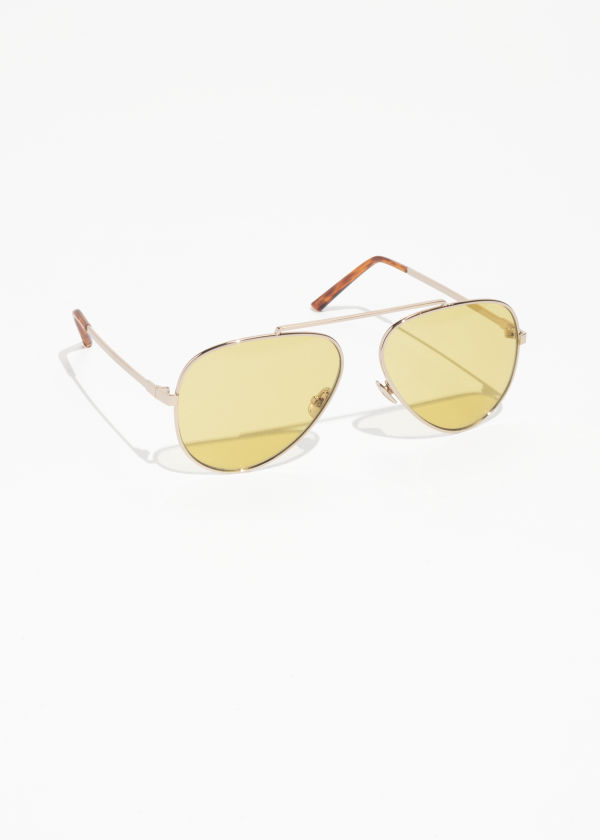 Front image of Stories tinted aviator sunglasses in yellow