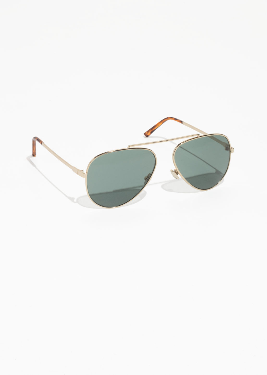 Front image of Stories tinted aviator sunglasses in gold