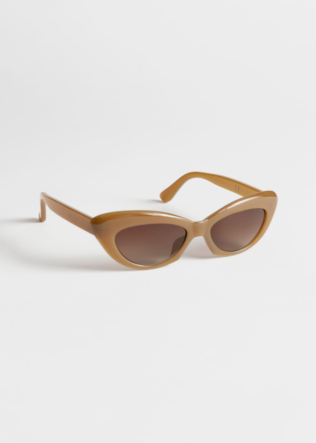 Front image of Stories rounded cat eye sunglasses in beige