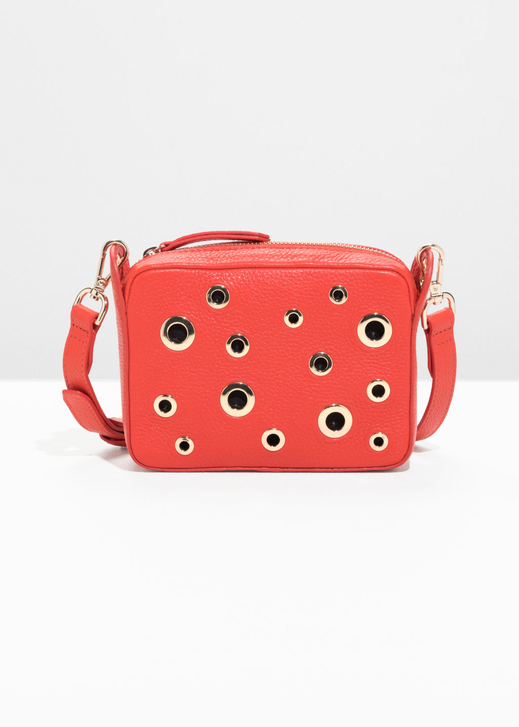 Front image of Stories grommet crossbody bag in red