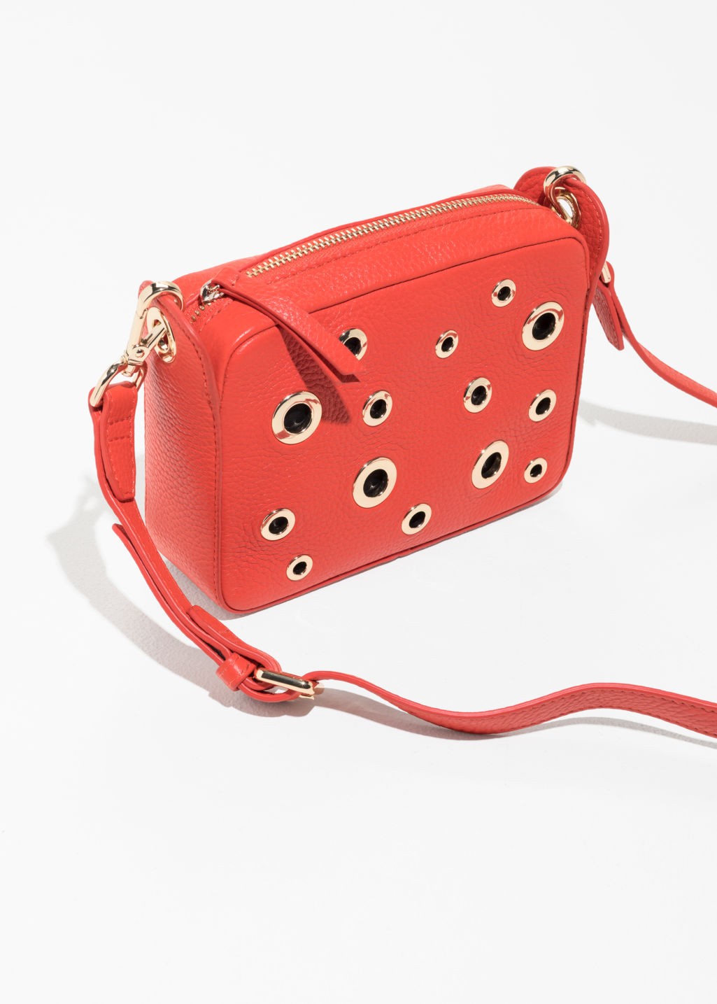 Back image of Stories grommet crossbody bag in red
