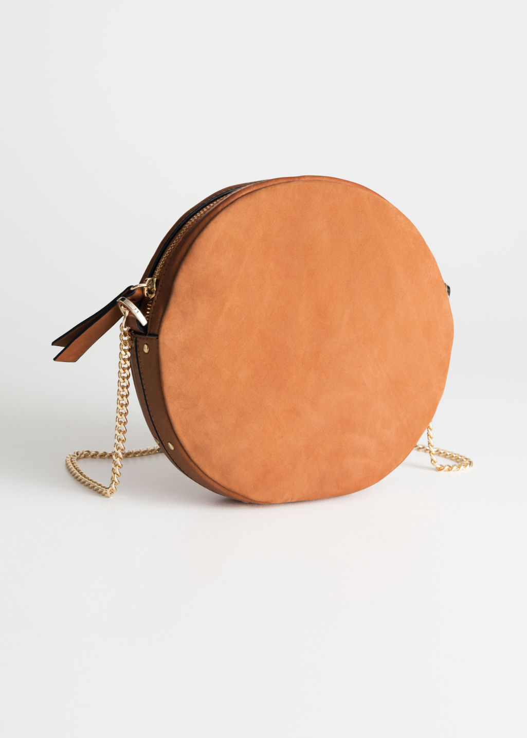 Front image of Stories small leather circle bag in beige