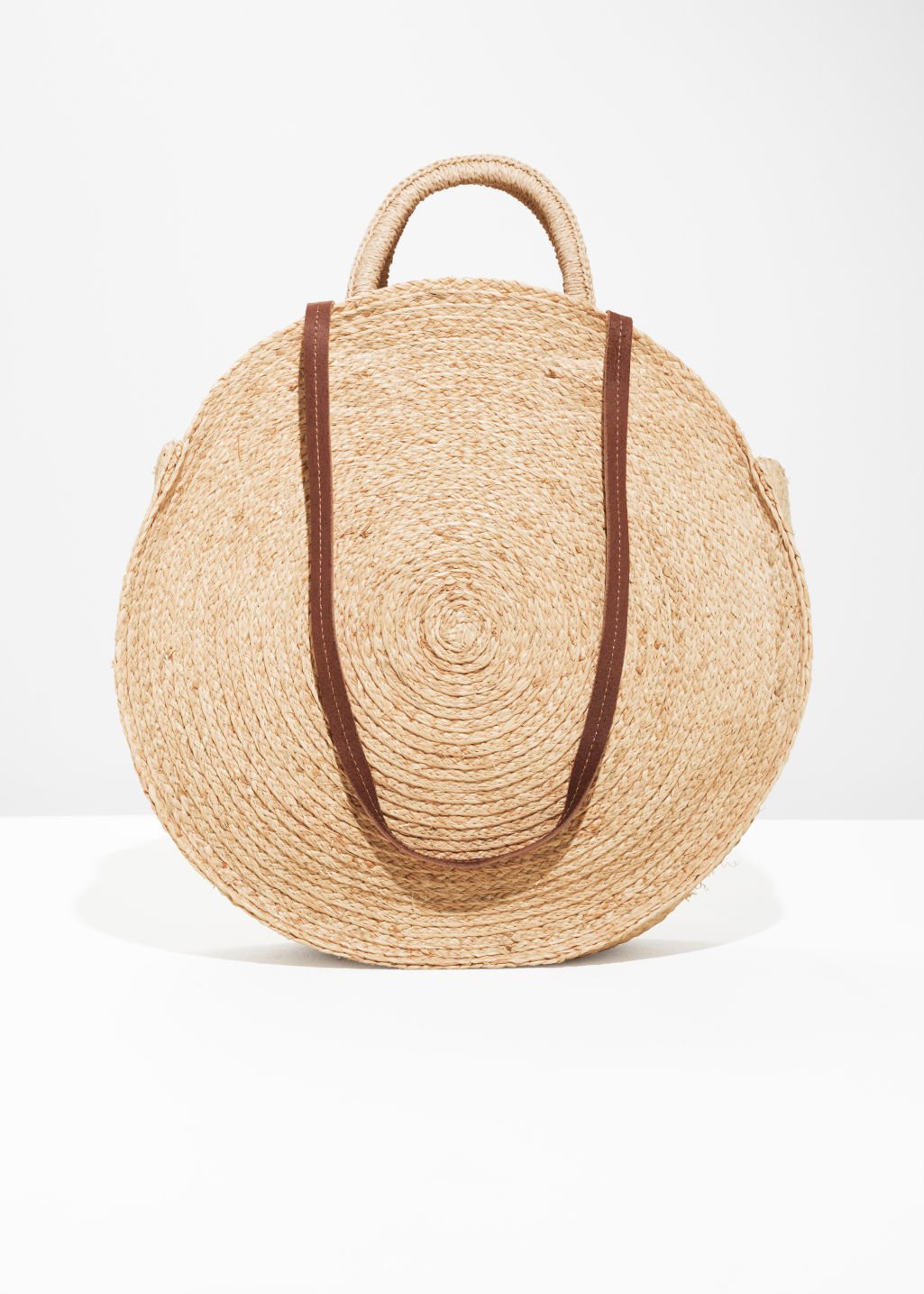 Back image of Stories straw circle bag in beige