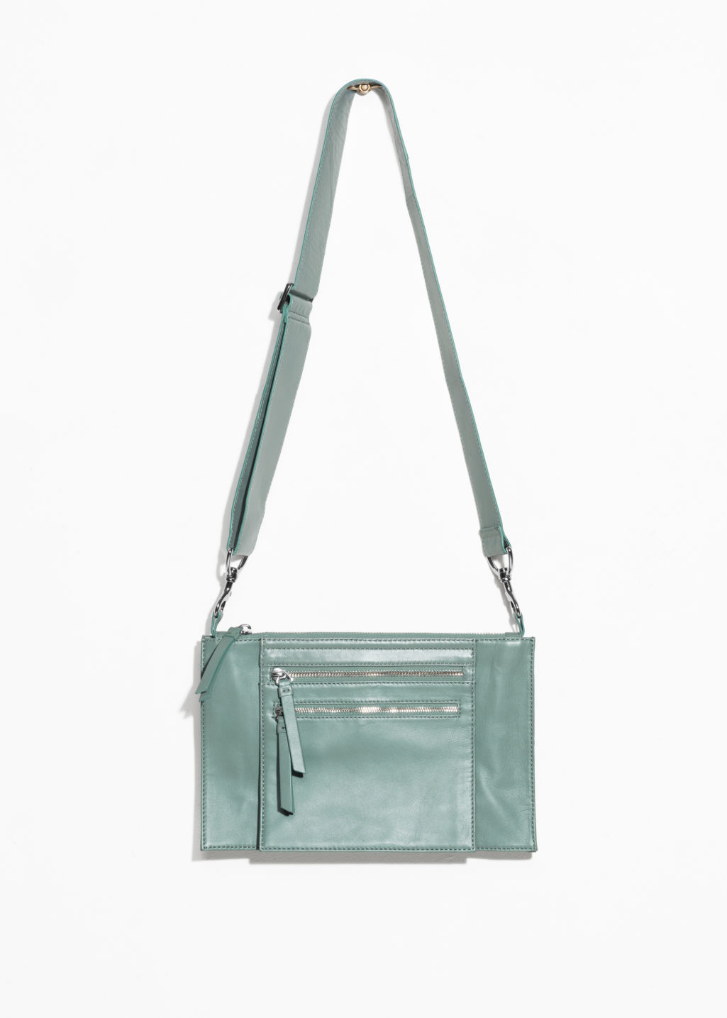 Front image of Stories utility crossbody  in green