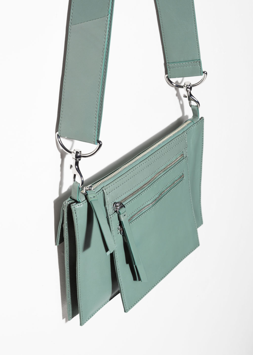 Back image of Stories utility crossbody  in green