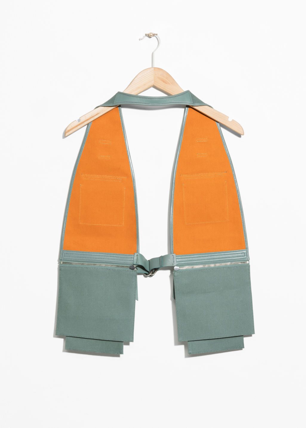 Back image of Stories utility body vest in green
