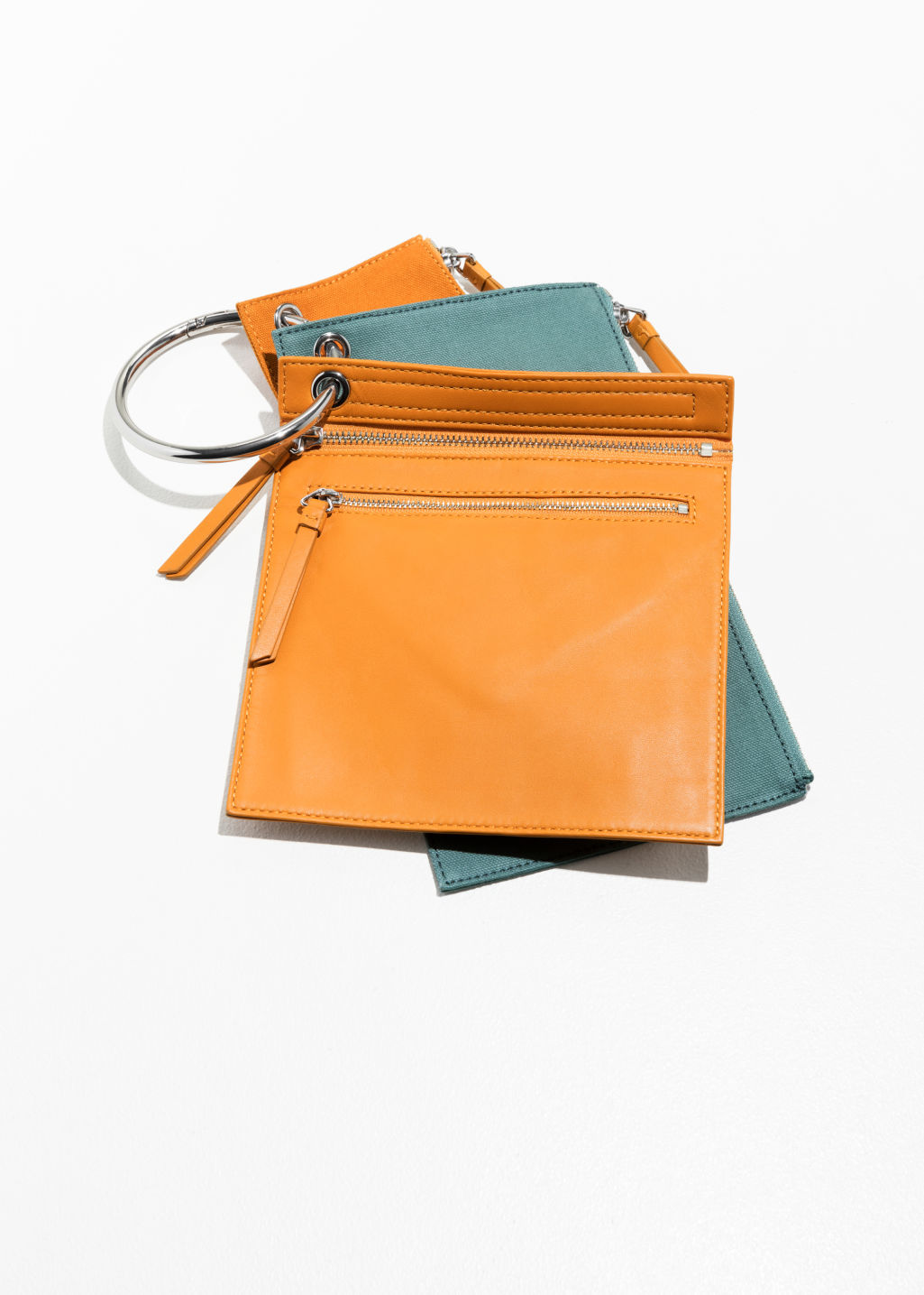 Front image of Stories utility keyring clutch in orange