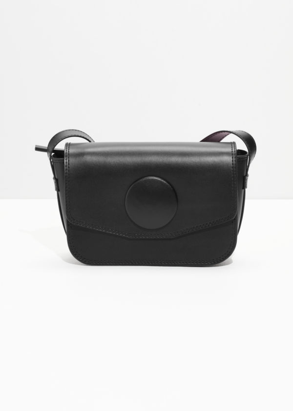 Front image of Stories mini snap saddle bag in black