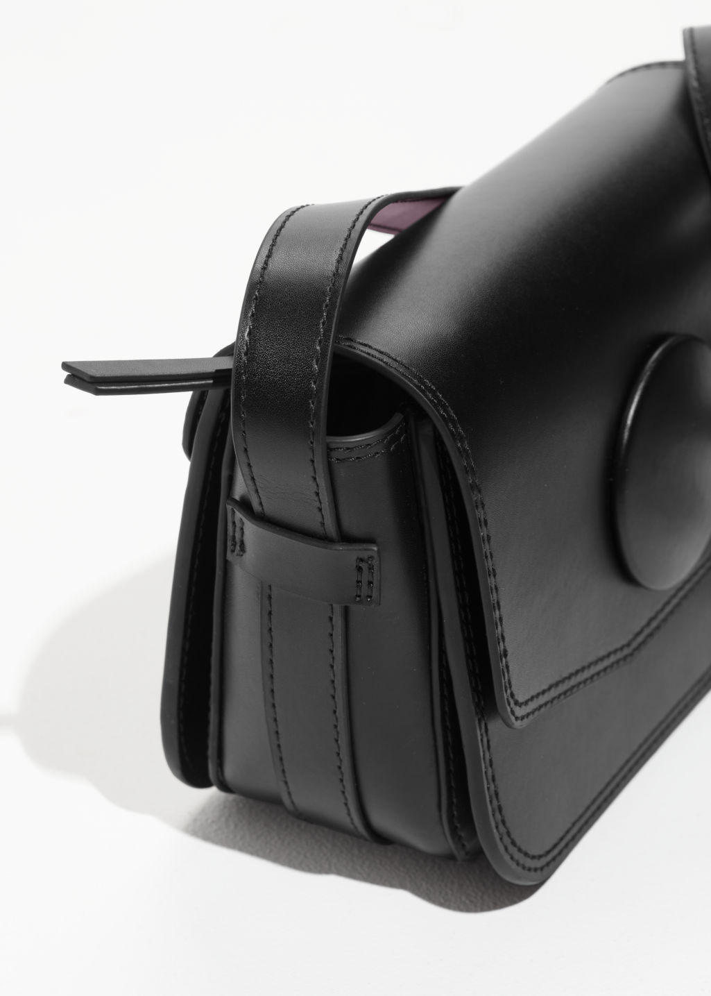Back image of Stories mini snap saddle bag in black