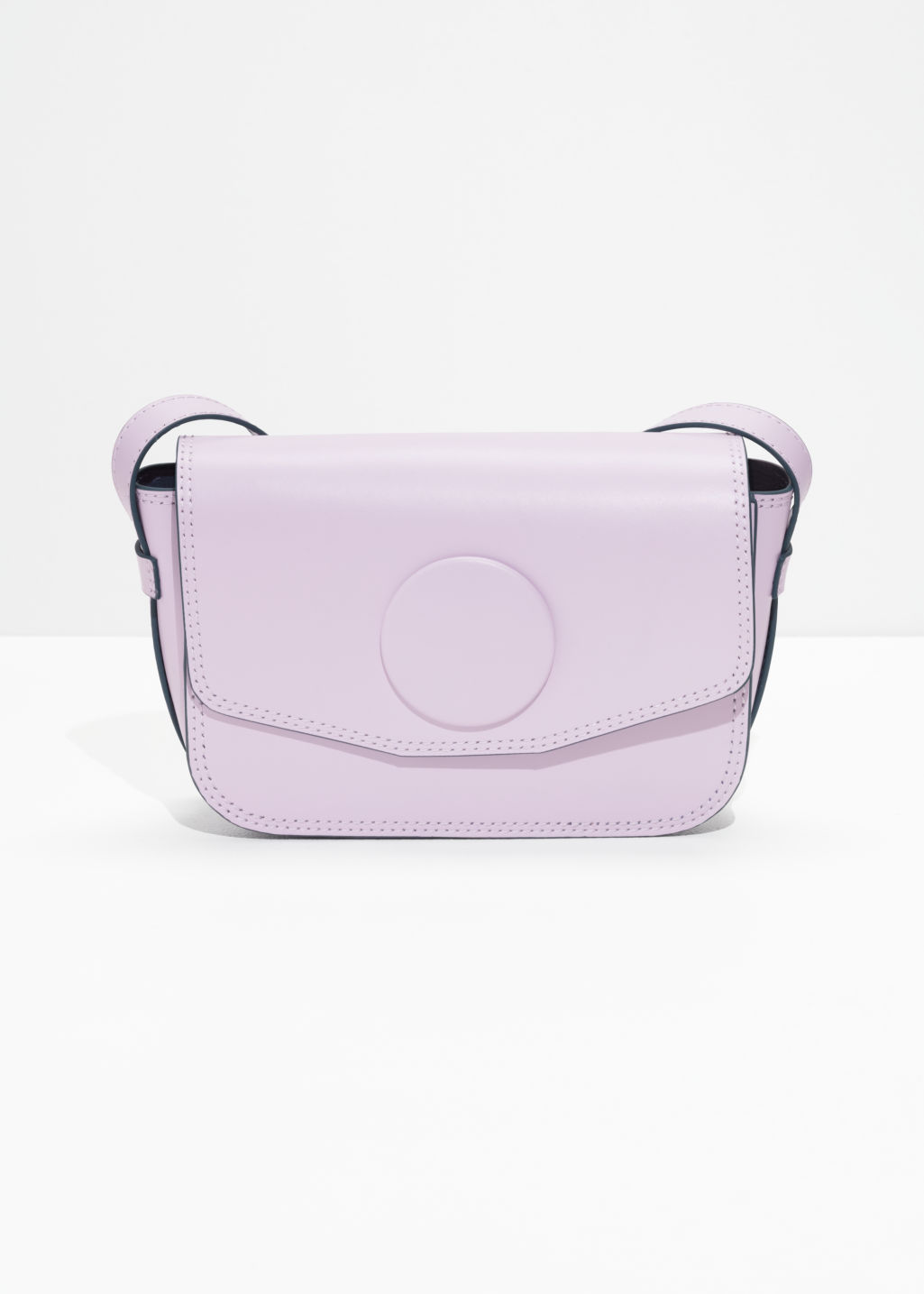 Front image of Stories mini snap saddle bag in pink
