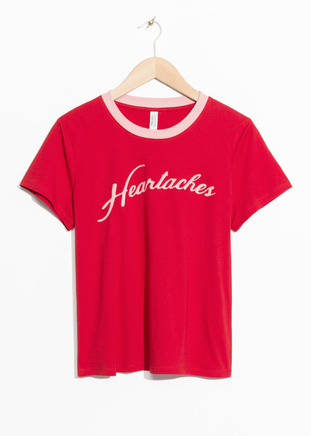 Front image of Stories heartaches cotton tee in red