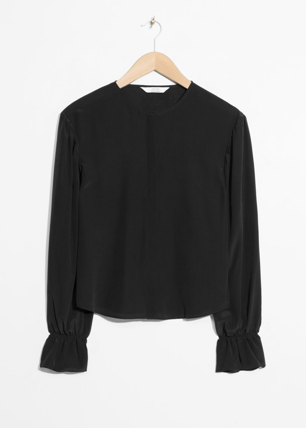 Front image of Stories dropped shoulder silk blouse in black