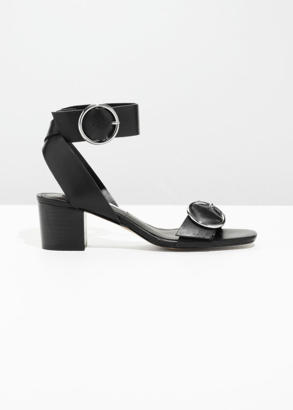 Front image of Stories circle buckle sandals in black