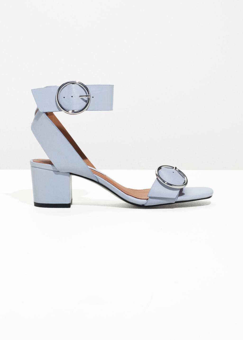 Front image of Stories circle buckle sandals in grey