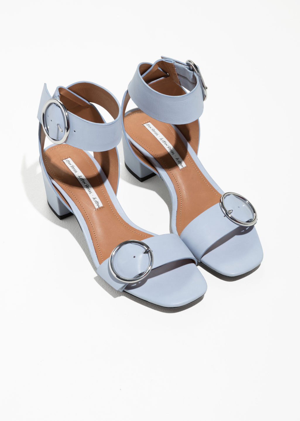 Back image of Stories circle buckle sandals in grey