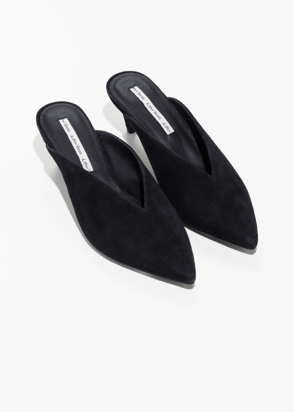 Back image of Stories pointed mule pumps in black
