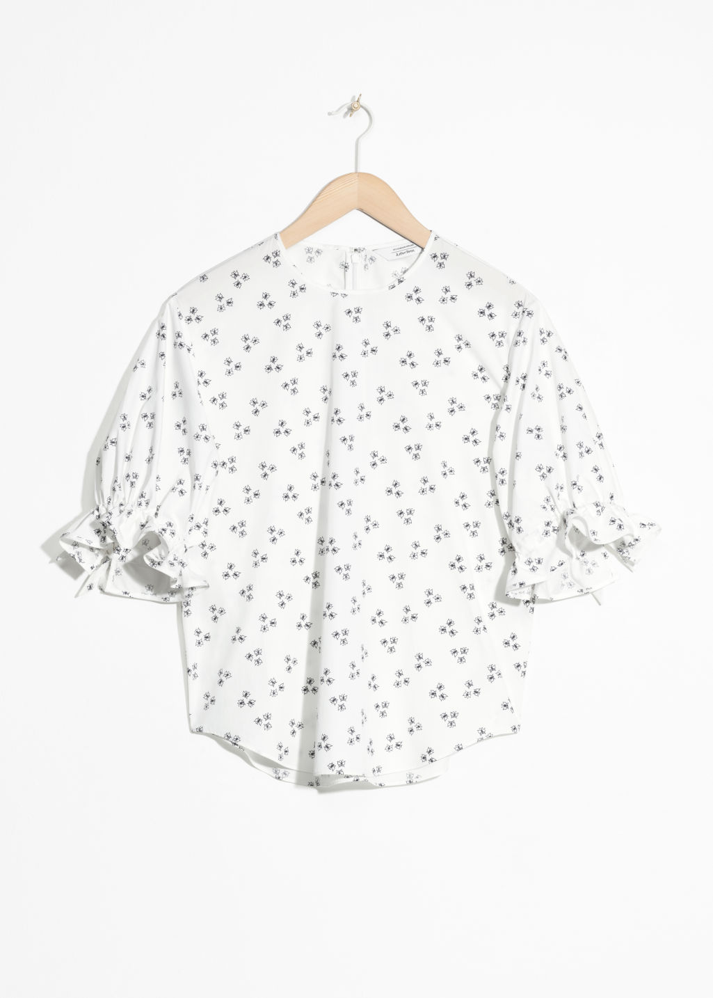 Front image of Stories printed cotton blouse  in white