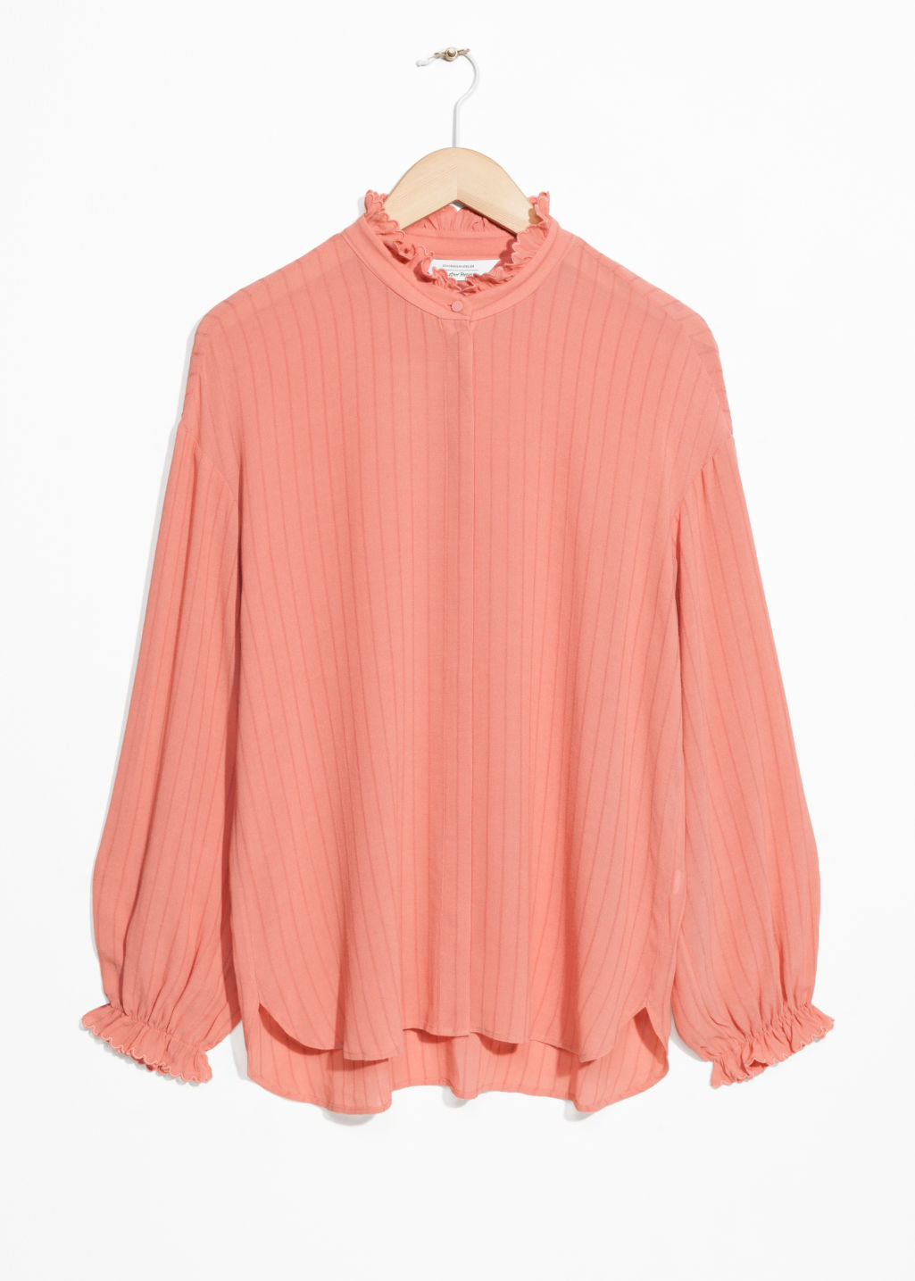Front image of Stories scalloped ruffle blouse in orange