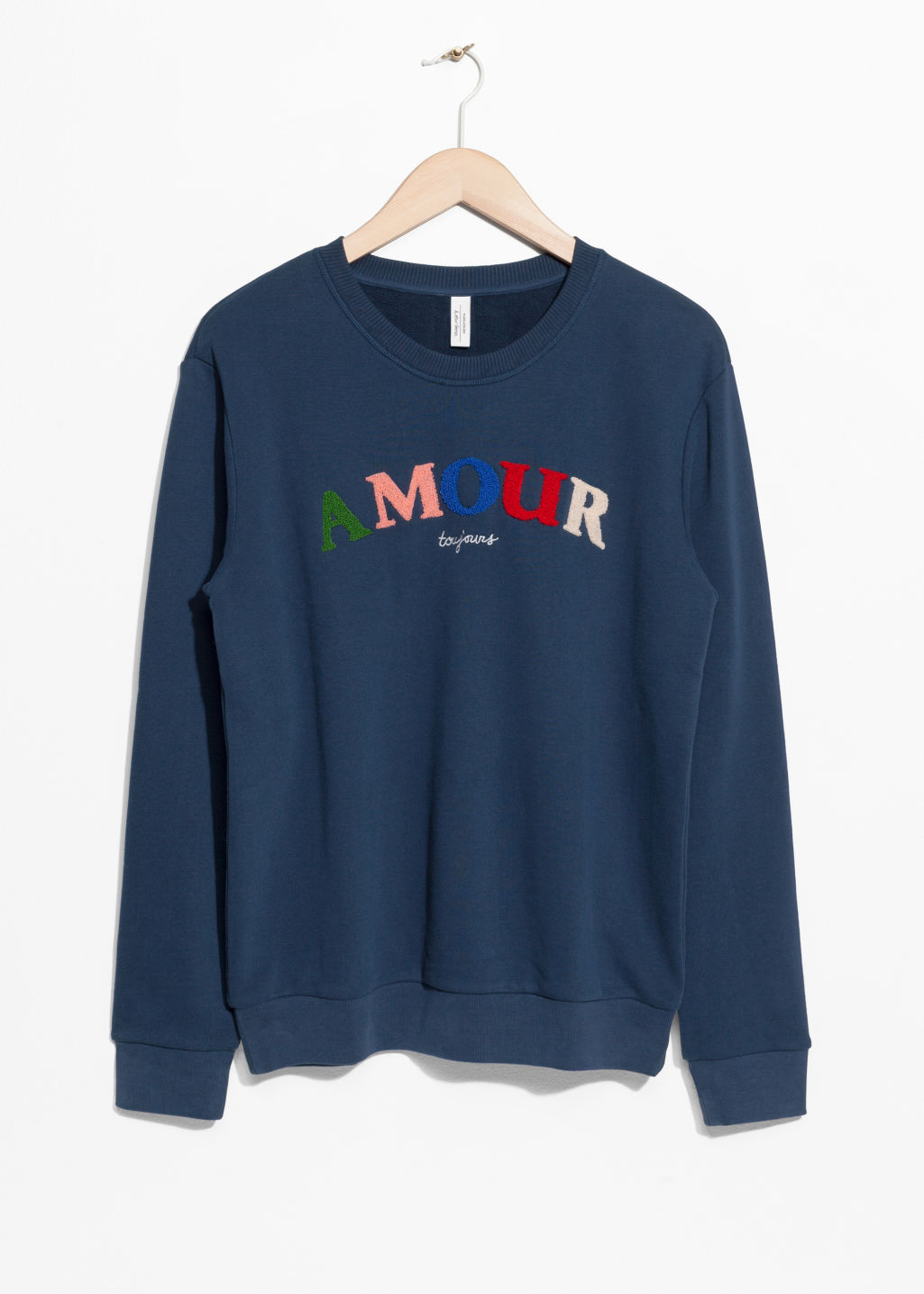Front image of Stories embroidered fleece sweatshirt in blue