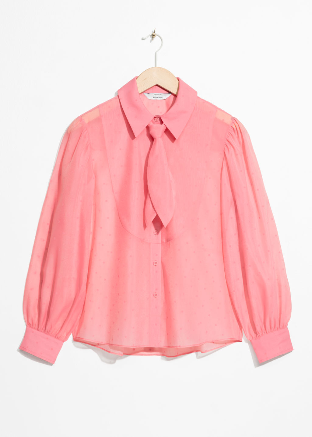 Front image of Stories sheer collared tie blouse in pink