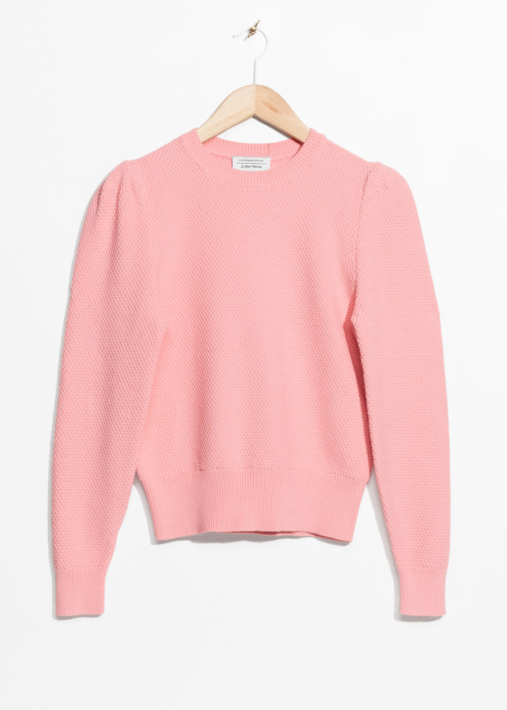 Front image of Stories shoulder puff sweater in pink