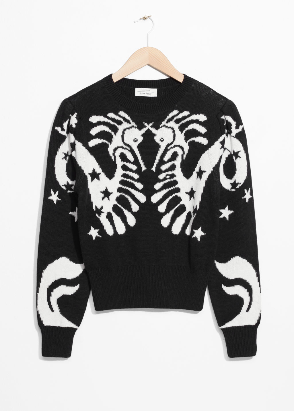 Front image of Stories seahorse jacquard sweater in black