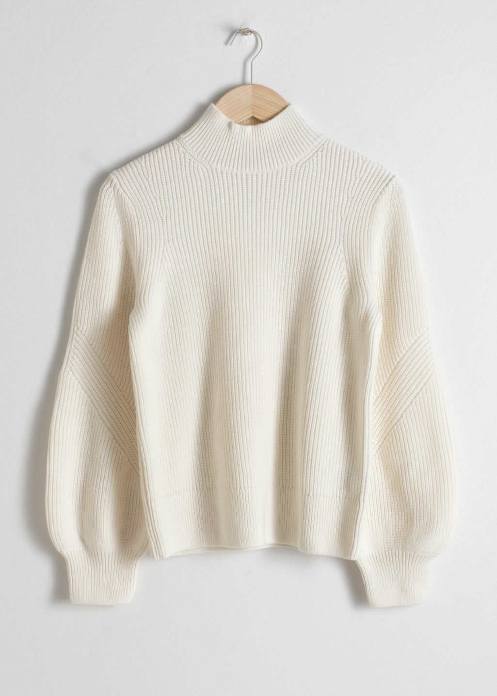 Front image of Stories puffy sleeve sweater in white