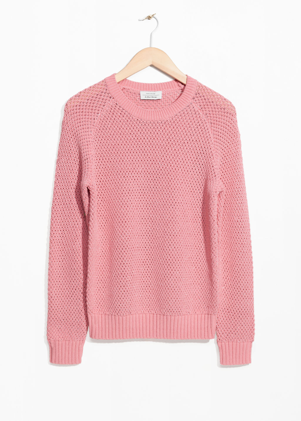 Front image of Stories micro honeycomb knit sweater in pink