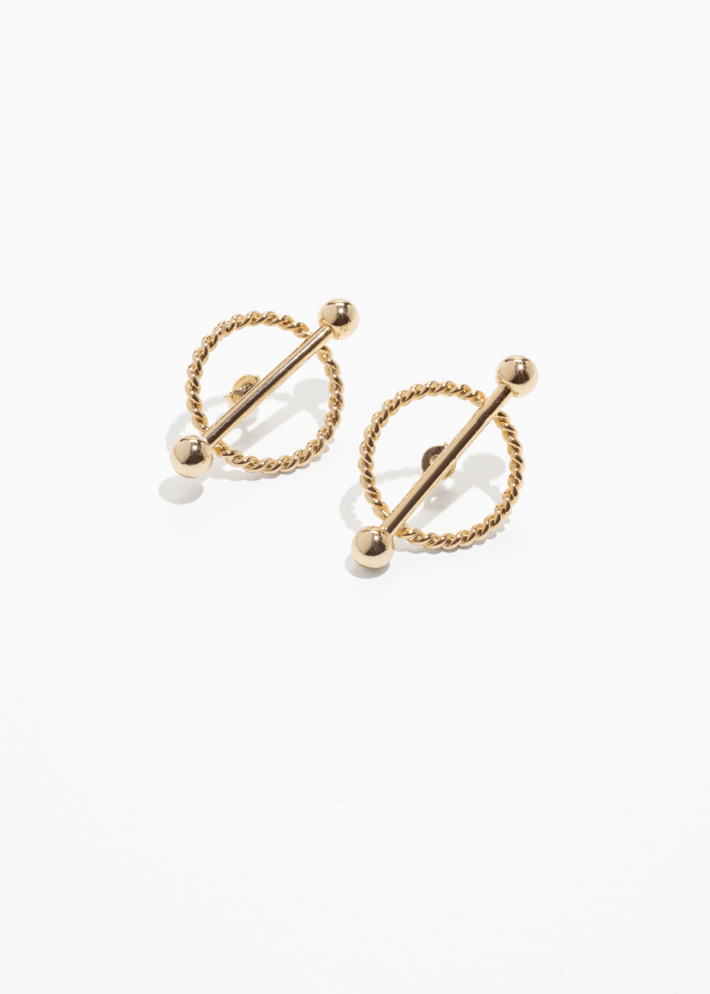 Front image of Stories twisted circle bar earrings in gold