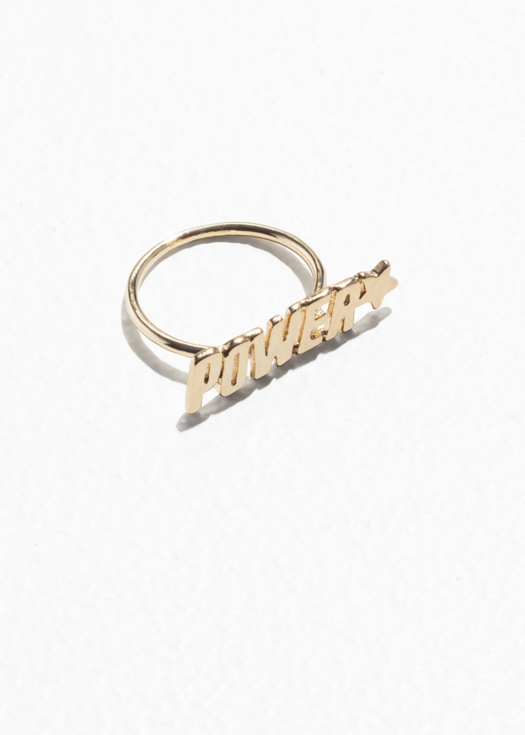 Front image of Stories power charm ring in gold