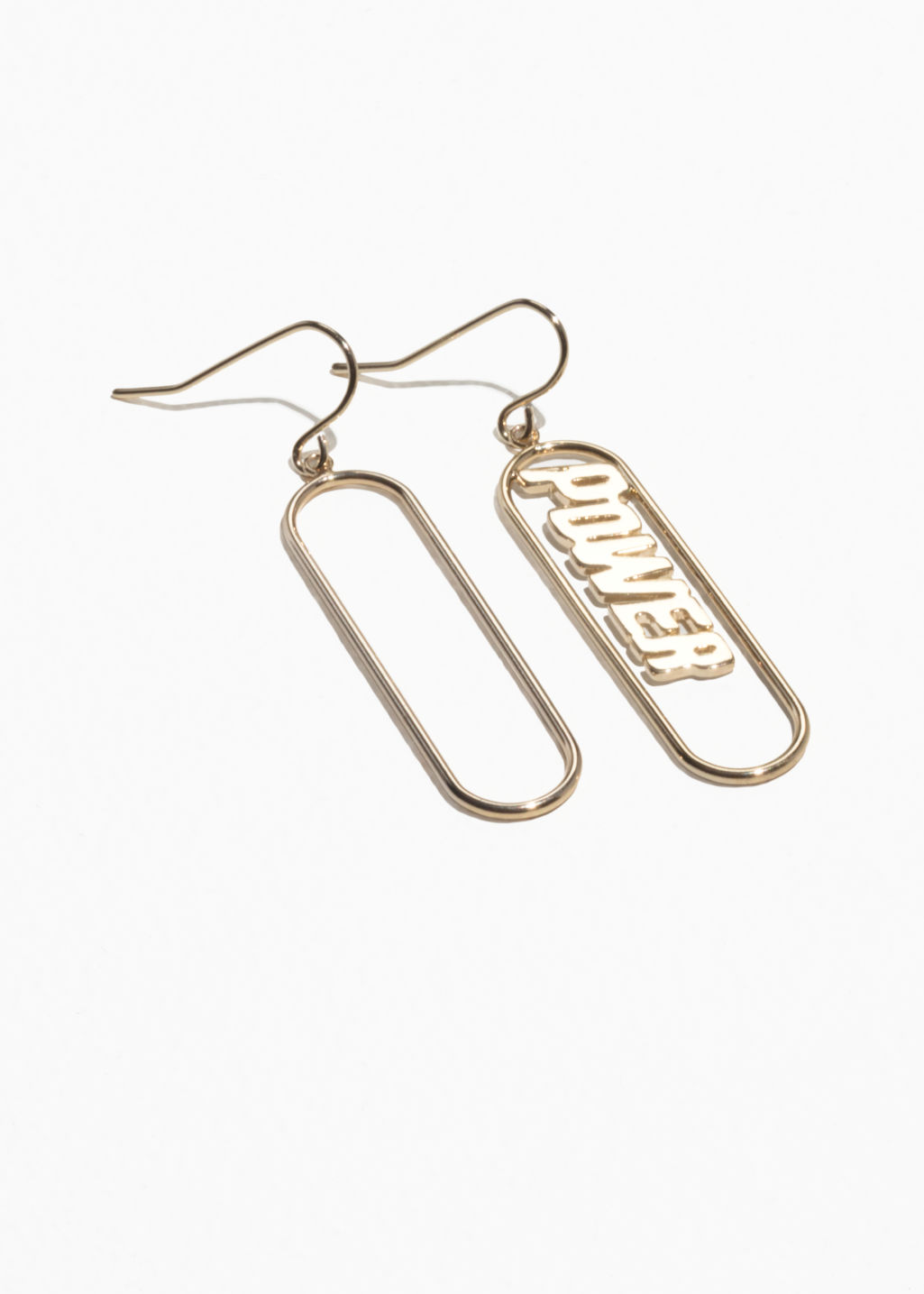 Front image of Stories power charm earrings in gold